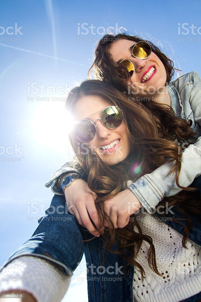 Selfie girls taking photos with a smartphone stock photo