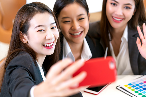 Selfie Group Of Asian Business Female Friend Smile Together Take Photo From  Smartphone With Happiness Cheerful Stock Photo - Download Image Now - iStock
