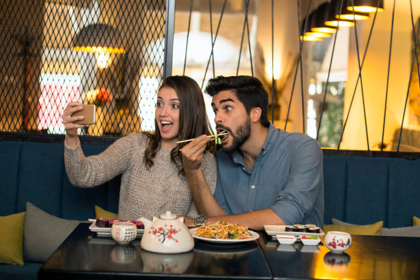 selfie in a restaurant - foodie stock photos and pictures