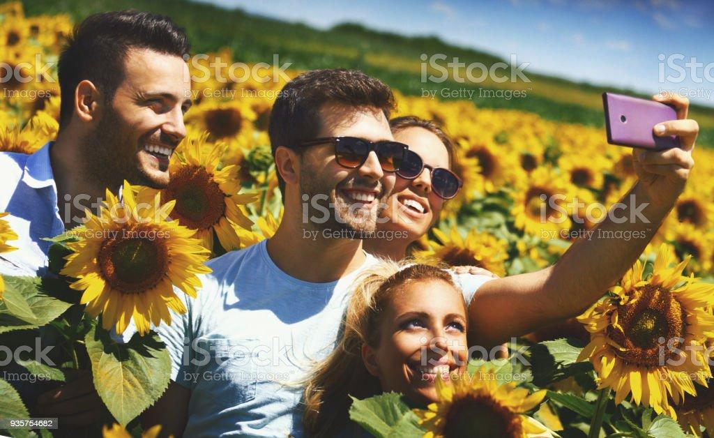 Selfie in a sunflower field. stock photo