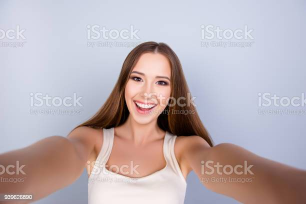 Selfie mania cute young girl with a beaming smile is taking a shot on picture id939626890?b=1&k=6&m=939626890&s=612x612&h=dc 6axze3uv imvtmw1aqqujzgpfpwyhwqwdnw3azls=