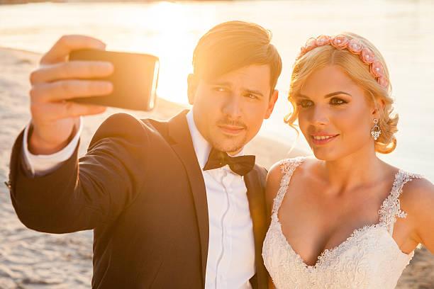 Selfie of bride and groom stock photo