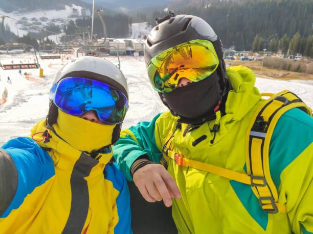 selfie of couple at ski resort stock photo