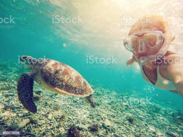 Selfie of girl with turtle underwater picture id950473038?b=1&k=6&m=950473038&s=612x612&h=65uroyti5myaklk6st seg6dcozd08ccieoks5e4ioq=