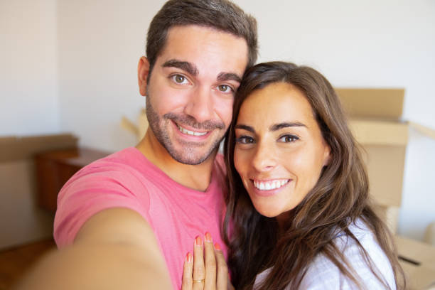 Selfie of happy young couple in their new home stock photo
