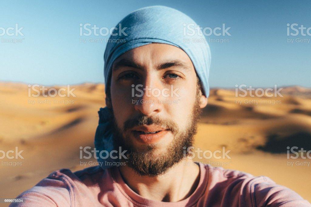 Selfie of man in the desert, Morocco stock photo