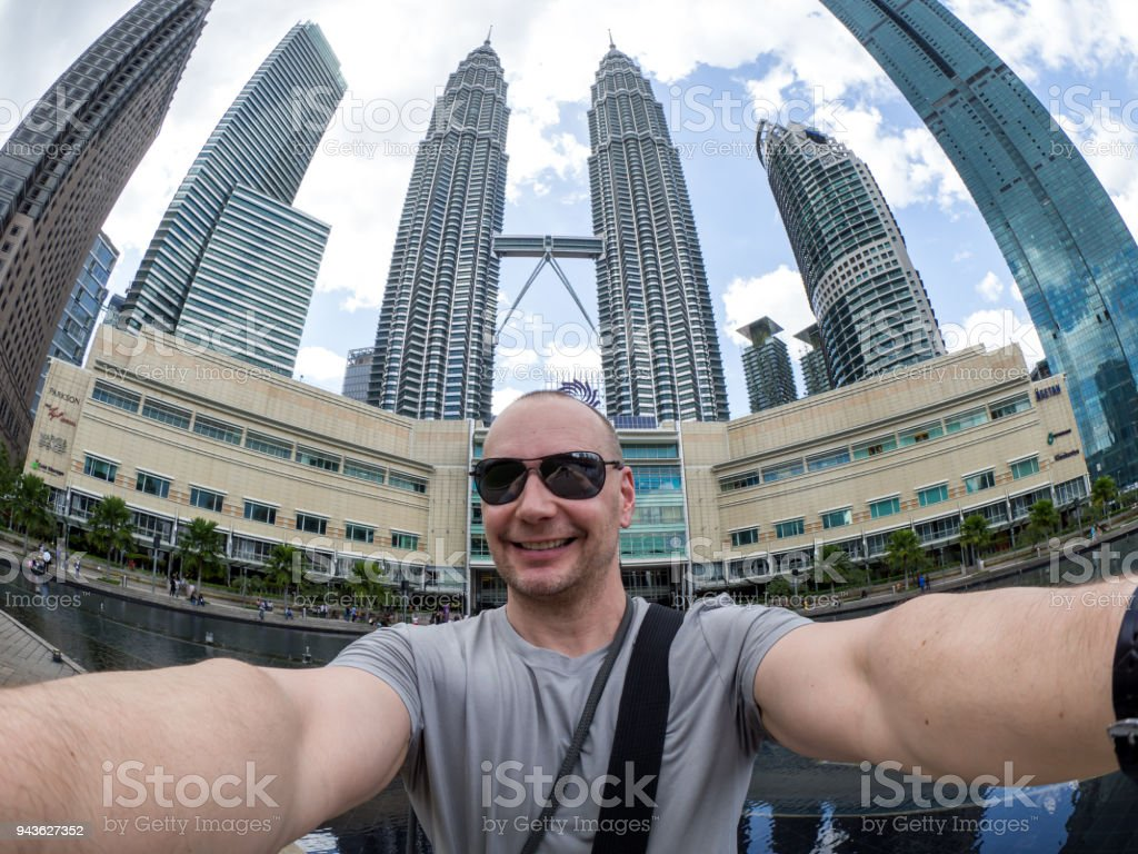 Selfie of man with Petrona Twin Towers in background stock photo