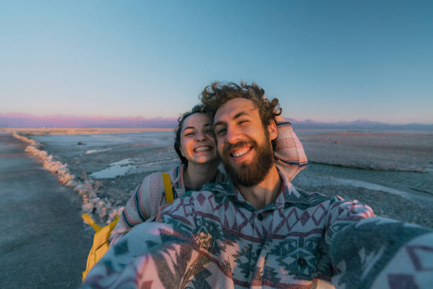 Selfie of woman and man near the  lake in Atacama desert stock photo