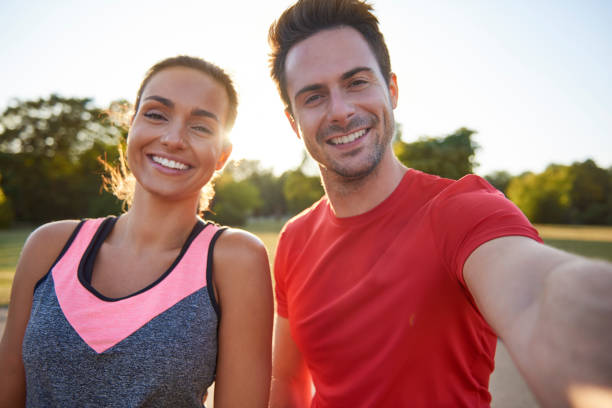 Selfie of young couple after workout on the fresh air stock photo