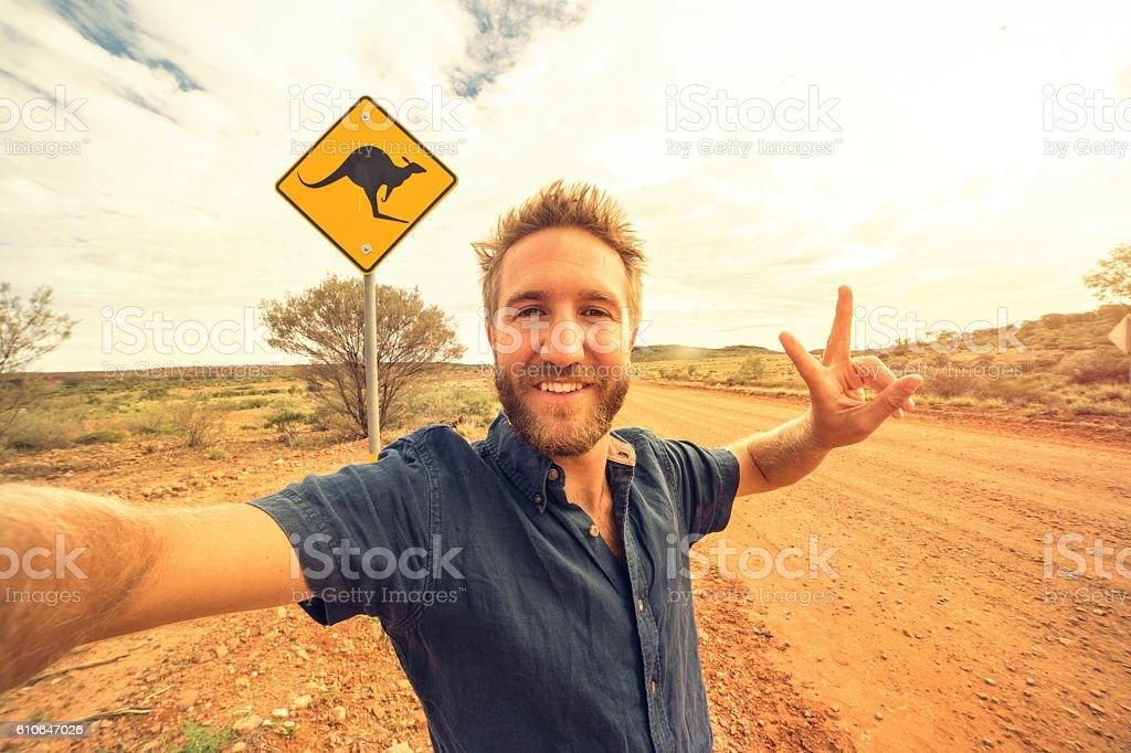 Selfie of young man in Australia standing near kangaroo sign stock photo