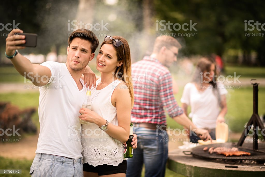 Selfie on a barbecue picnic - Photo