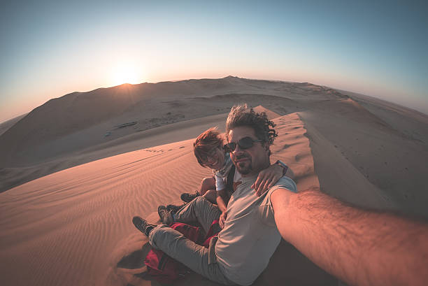 selfie on sand dunes in the namib desert, namibia, africa - afrikareise stock-fotos und bilder