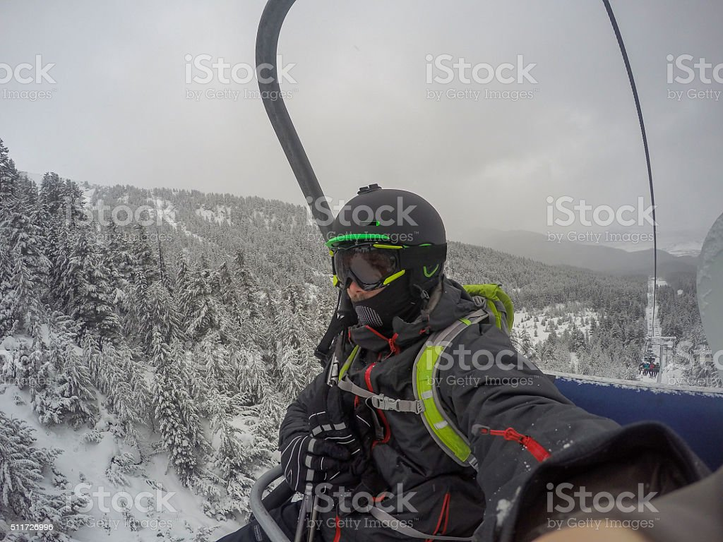 selfie on the chairlift on a cold foggy day stock photo