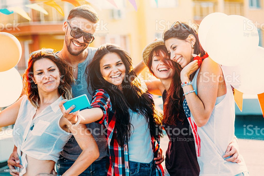 Selfie on the roof A group of friends having a party and taking a selfie on the roof 20-29 Years Stock Photo