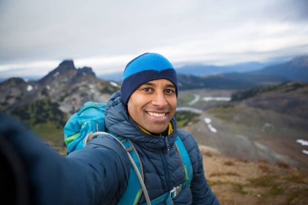 Selfie on top of the mountain stock photo