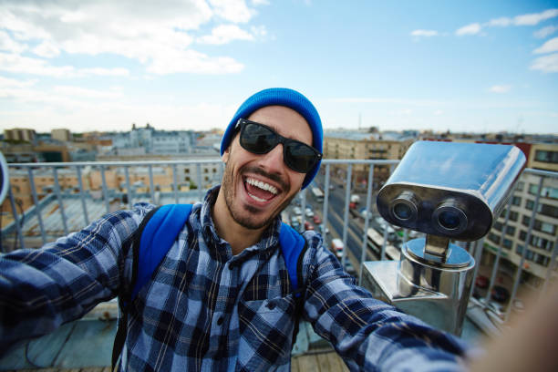 selfie on travel - vlogger stock photos and pictures
