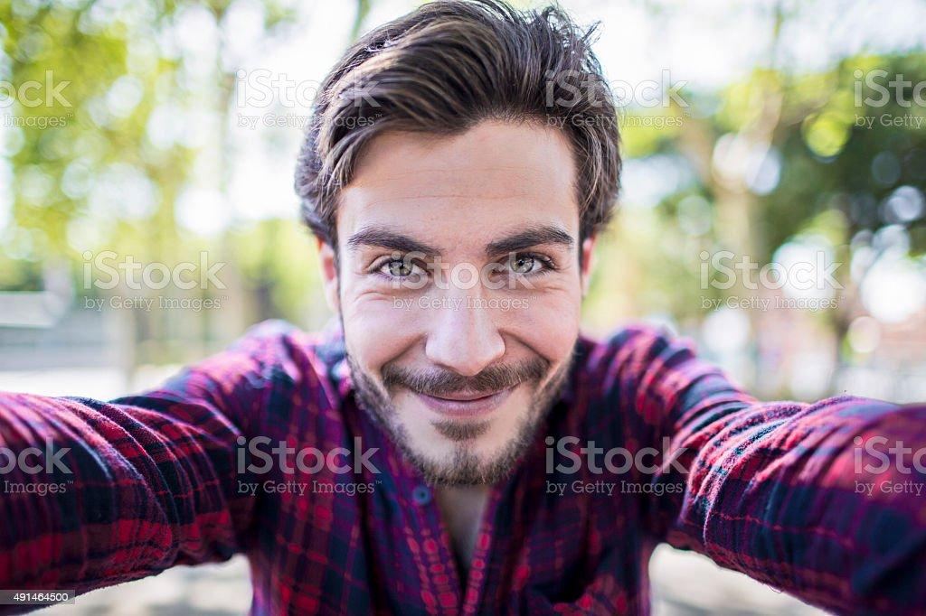 Young urban man taking a selfie