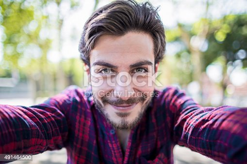 Young urban man taking a selfie