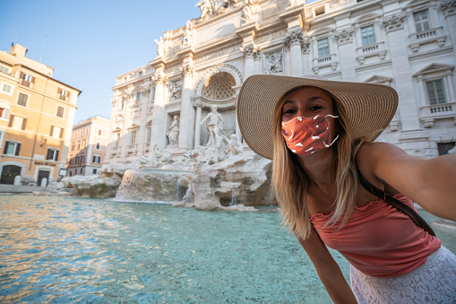 Selfie portrait of young couple in Rome at the Trevi fountain, Italy