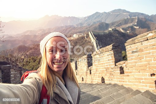 istock Selfie portrait of young woman on Great Wall of China 639590036
