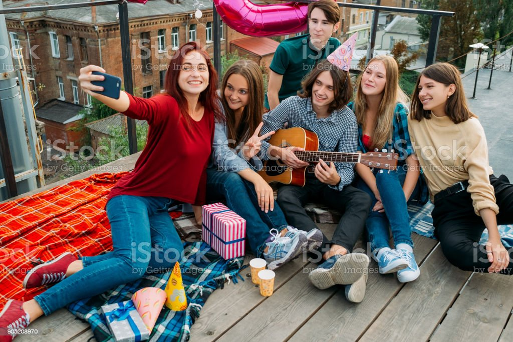 selfie rooftop friends share youth bff lifestyle stock photo