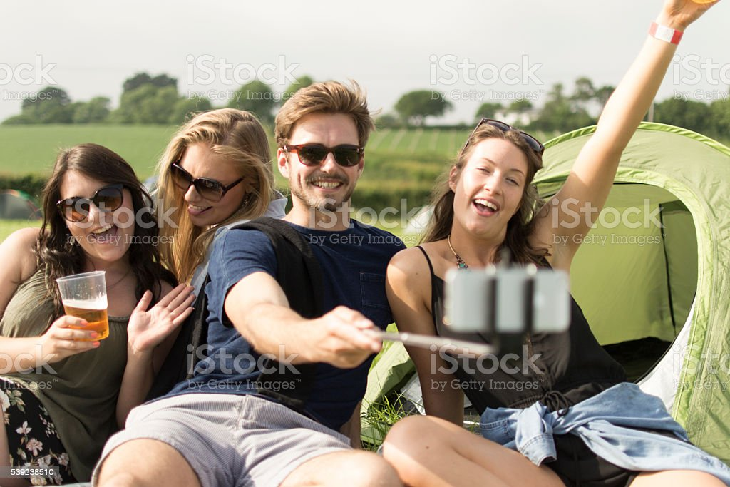 Selfie stick and camping royalty-free stock photo