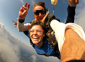 istock Selfie tandem skydiving with pretty woman 1049433944