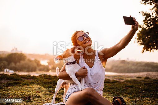 636418612 istock photo Selfie time! The woman and the dog are the most beautiful. 1033284032
