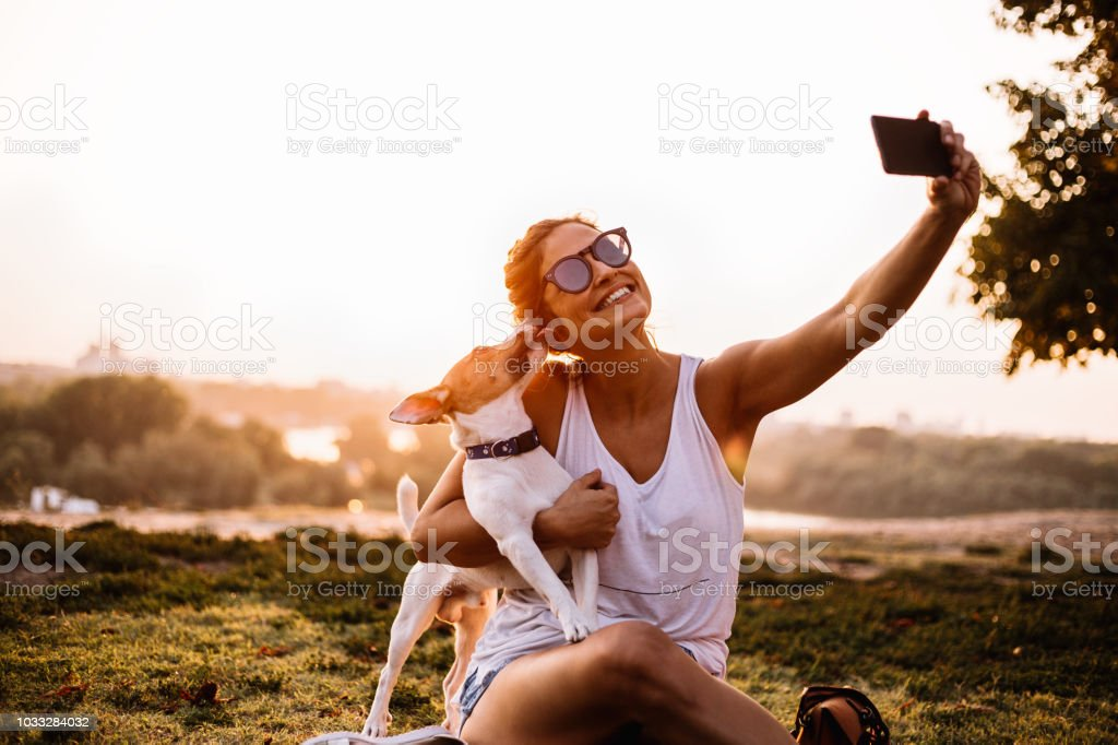 Selfie time! The woman and the dog are the most beautiful. stock photo