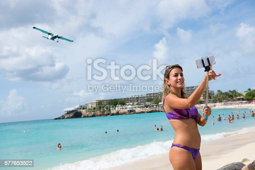 selfie with airplane at maho beach on st maarten stock photo 577653522 istock. Black Bedroom Furniture Sets. Home Design Ideas