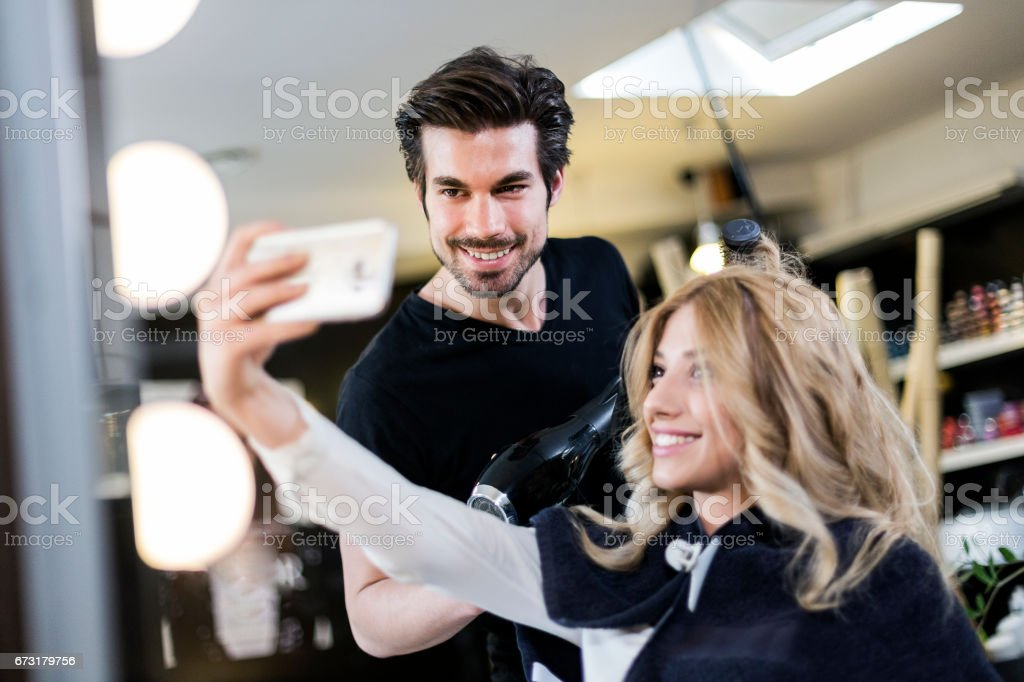 Selfie with hairdresser stock photo