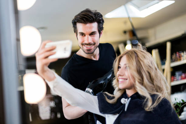 selfie with hairdresser - beauty salon stock photos and pictures