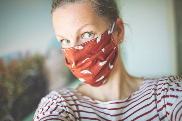Selfie with self-made mask to protect against viruses and bacteria stock photo