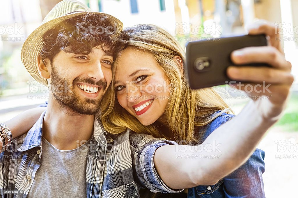 Selfie with Smartphone, Happy Young Couple stock photo