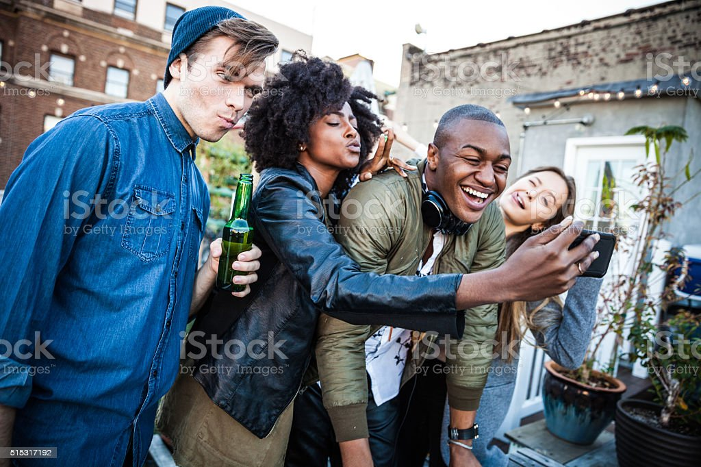 Selfie with the DJ at the rooftop party in NYC stock photo