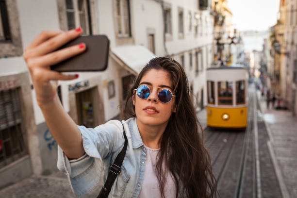 Selfie with The Old Tram in Lisbon stock photo