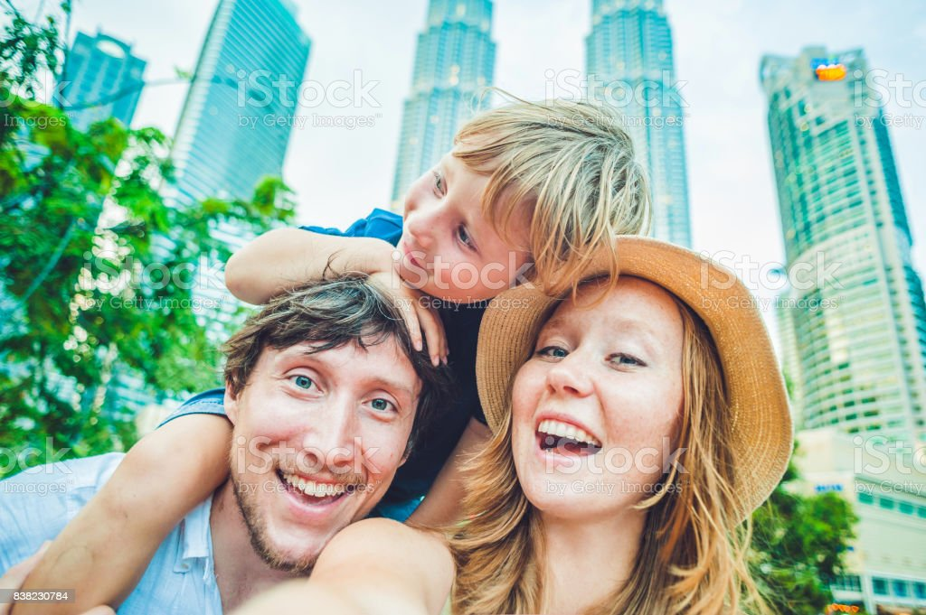 Selfies family on the background of skyscrapers. tourism, travel, people, leisure and technology concept stock photo