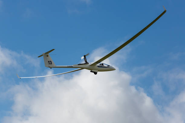 self-launching glider taking off - stephen lynn stock pictures, royalty-free photos & images