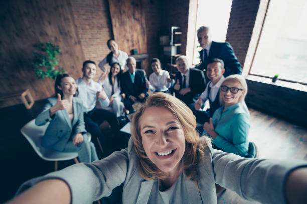 self-portrait above high angle view of nice stylish cheerful glad positive director company staff showing thumbsup yes goal achievement recommend modern industrial loft interior work place open space - cultures stock pictures, royalty-free photos & images