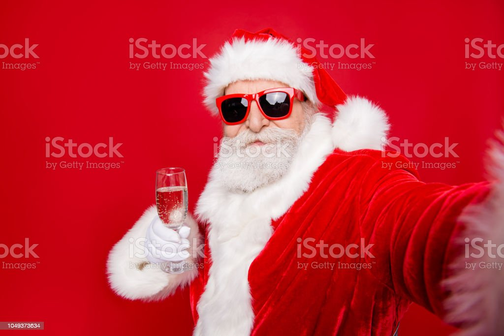 Self-portrait of glad cheerful dreamy Santa congratulations best wishes holding wineglass prepared ready to countdown isolated over bright vivid red background stock photo