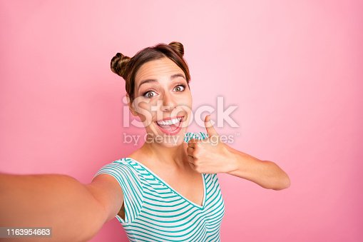 Self-portrait of her she nice-looking lovely lovable shine adorable, charming cute cheerful cheery positive girl showing thumbup advert ad isolated over pink pastel background