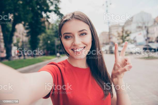 Selfportrait of straighthaired young beautiful smiling girl wearing picture id1058652758?b=1&k=6&m=1058652758&s=612x612&h=f4vl8j1sb9vno4 sicp0opvvryo26hswvnnycthcvrq=