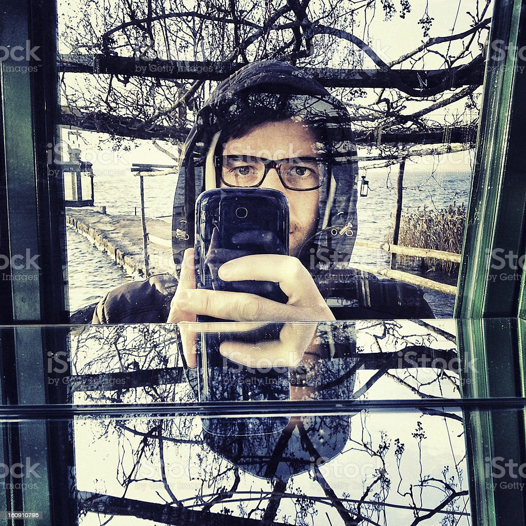 Selfportrait, Photographer with Mobile Phone royalty-free stock photo