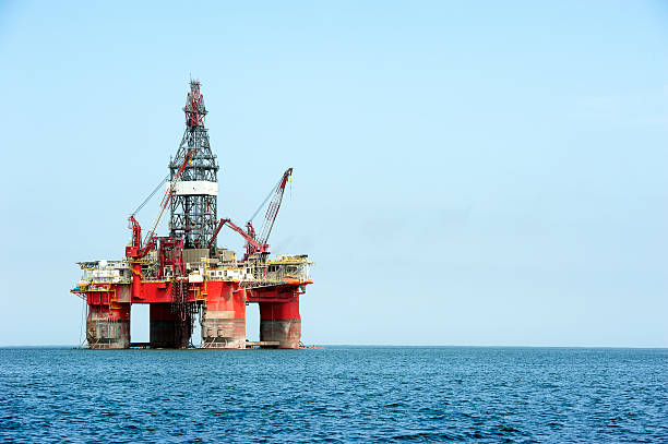 self-propelled oil rig, walvis bay, namibia, africa - angola stock photos and pictures