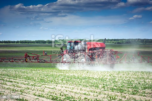 Vinnitsa/Ukraine - 05/22/2018: self-propelled sprayer makes herbicide on the field of young corn
