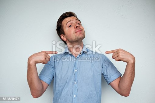 istock Self-satisfied and proud caucasian young man looks forward 874829474