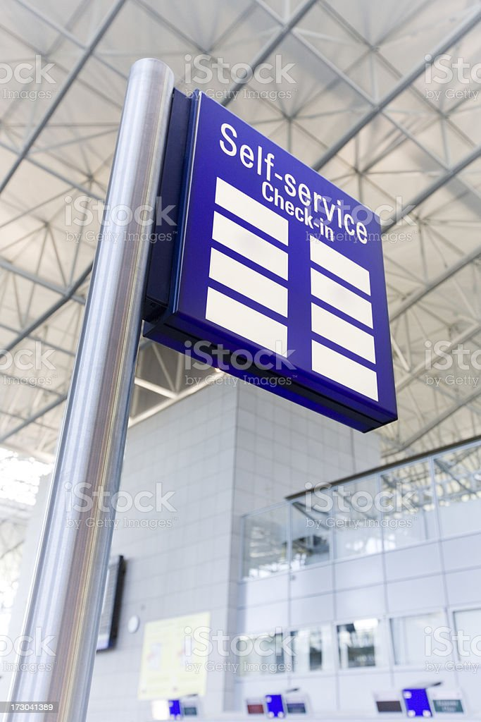 Self-Service Check-In Sign royalty-free stock photo
