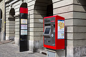Bern, Switzerland - April 17, 2017: Self-service tickets machine at Zytglogge trolleybus station. There is a visible post with a timetable