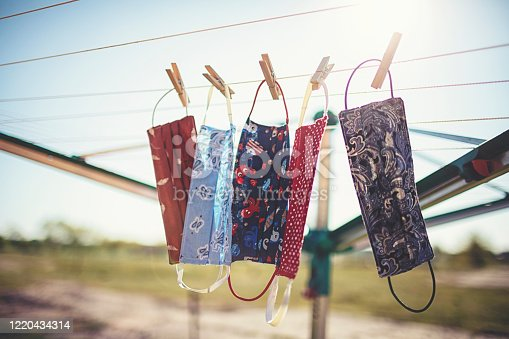 Self-sewn mouth-nose masks against corona viruses hang on the clothesline to dry.