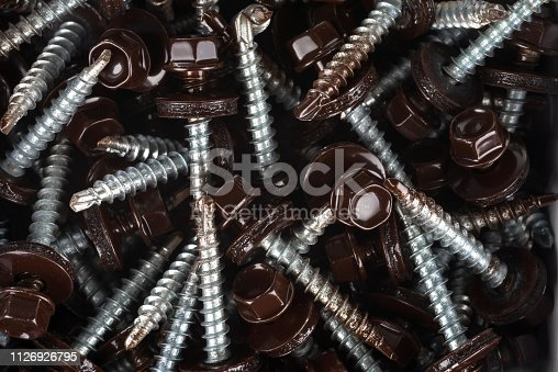 Self-tapping screws for fixing the roof with brown hex heads.